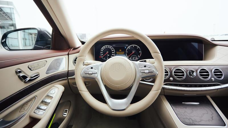 Car interior luxury. Interior of prestige modern car. Leather comfortable seats, dashboard and steering wheel. White stock images