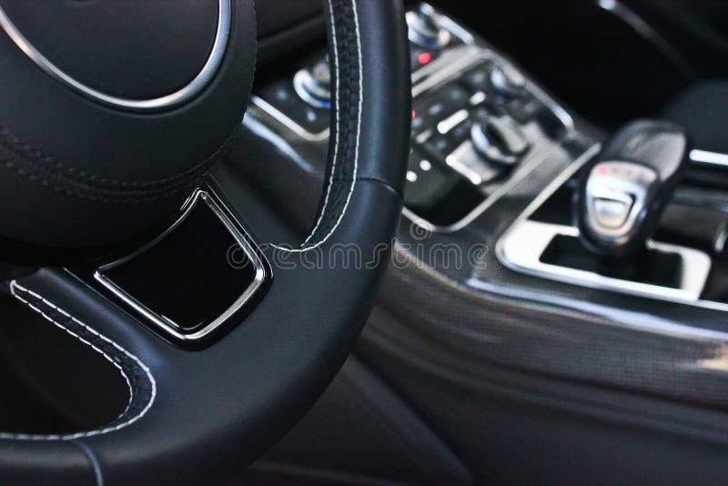 Car interior luxury service. Car interior details. Black stock image