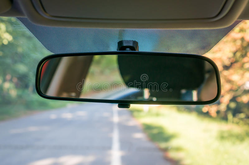 Car interior with rear view mirror and windshield. Vehicle interior with rear view mirror and windshield - car salon concept stock images