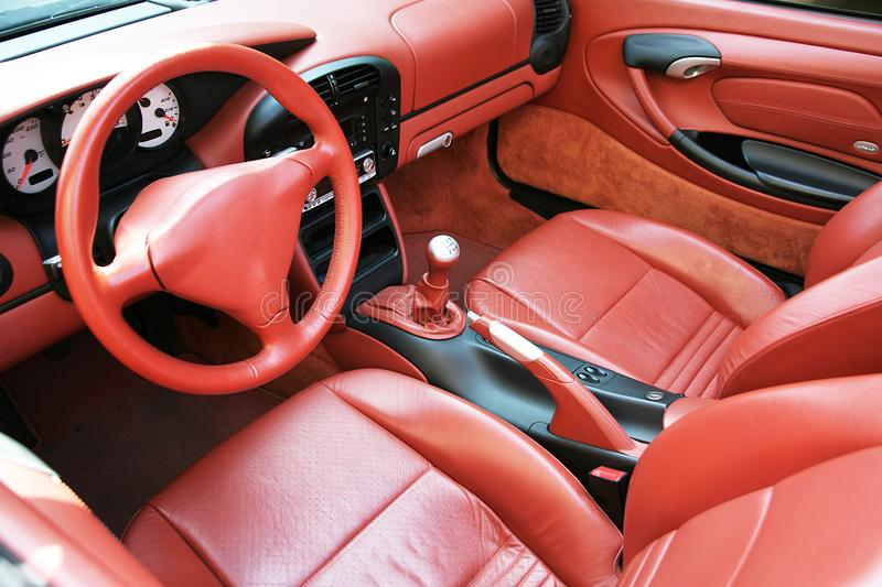 Car interior in red leather stock photos