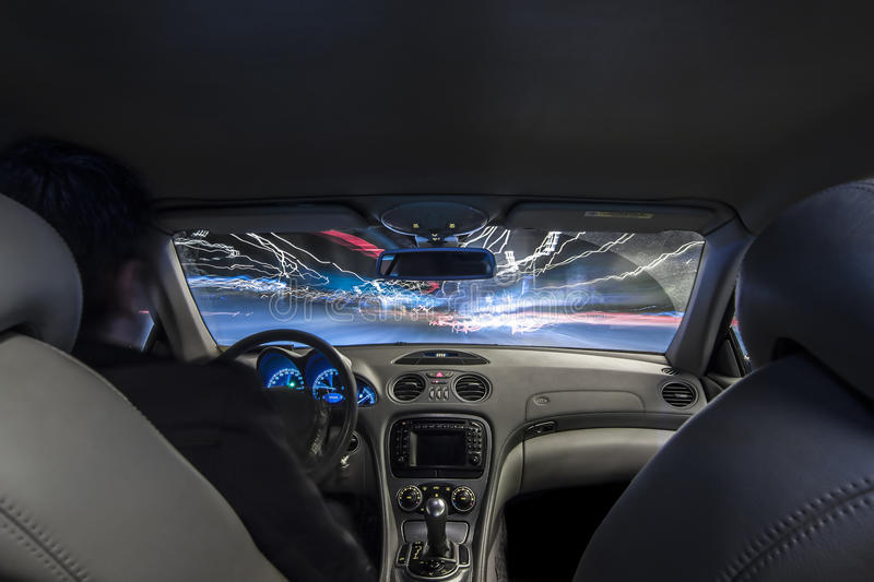 Car interior speed driving. In blurry long exposure royalty free stock photography