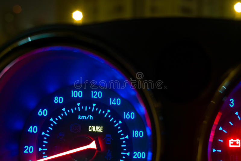 Car Interior. Speedometer controls illuminated blue stock photo