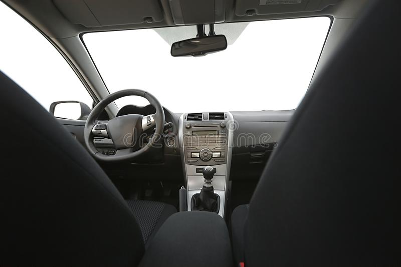 Car Interior. View of the dashboard from the back stock photo