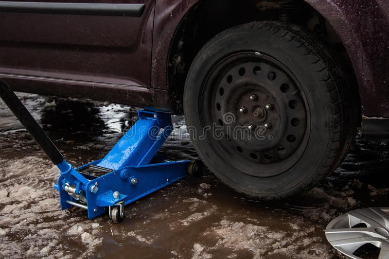 Car jack up for lifting wheels, auto repair.  royalty free stock photos