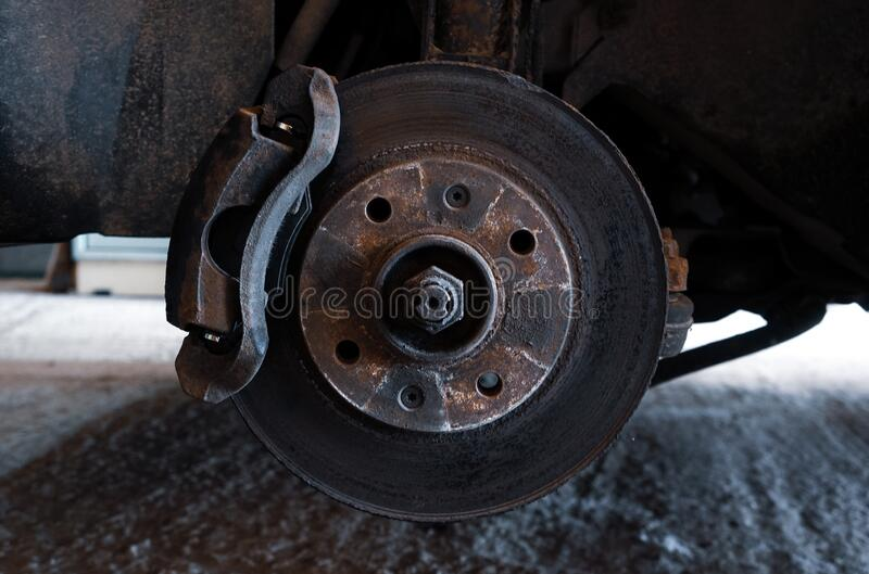 Car on a jack without a wheel. Brake pad replacement, car repair stock photography