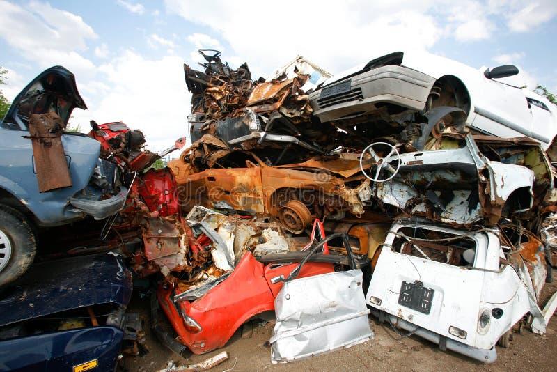 Car junkyard. Cars piled on top of each other in junkyard royalty free stock photo