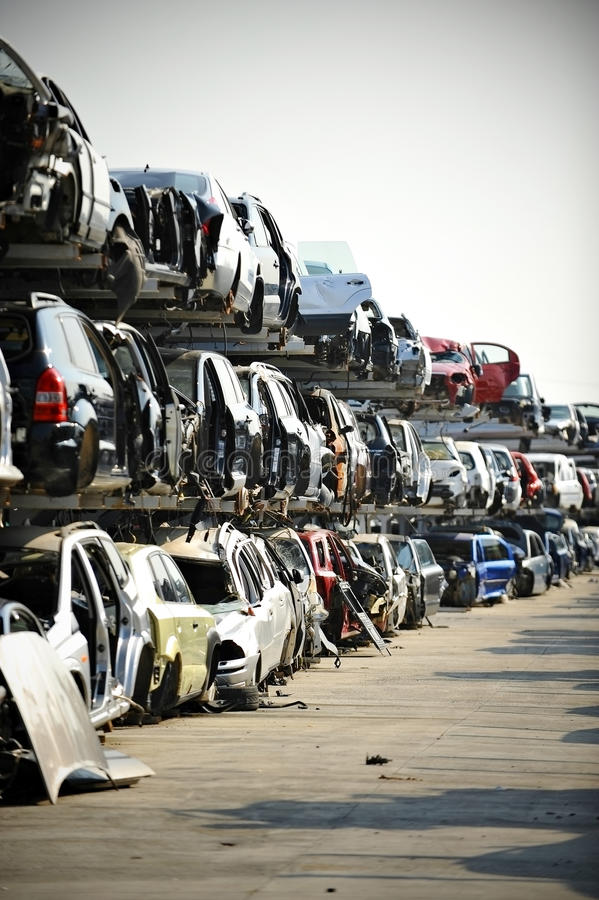 Car junkyard. Wrecked vehicles are seen in a car junkyard stock photos