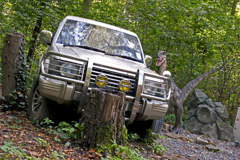 Car in jurassic park. Off-road car and dinosaur in the jurassic park royalty free stock images