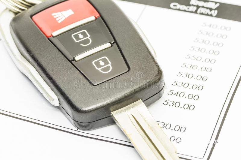 Car key on bank statement stock images