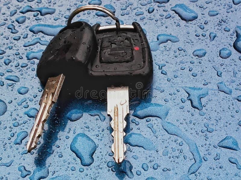 Car key    on blue rainy metal  surface royalty free stock image