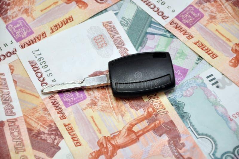 Car key on cash. Car keys on money cashnotes background stock images