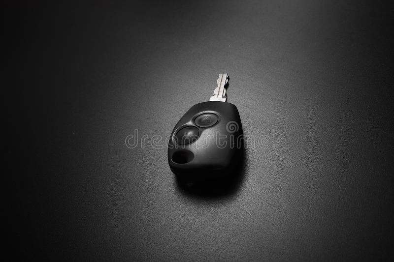 Car key with central lock on black background. Car key with central lock on black background royalty free stock photography