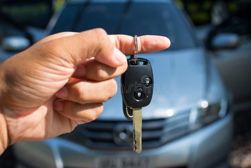 Car key in hand royalty free stock photos