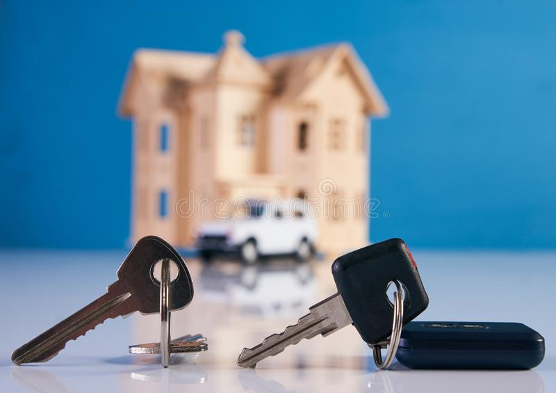 Car key and house keys with new automobile and home royalty free stock images