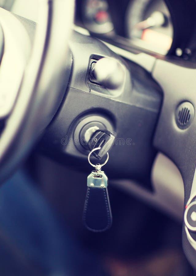 Car key in ignition start lock. Transportation and ownership concept - car key in ignition start lock stock image