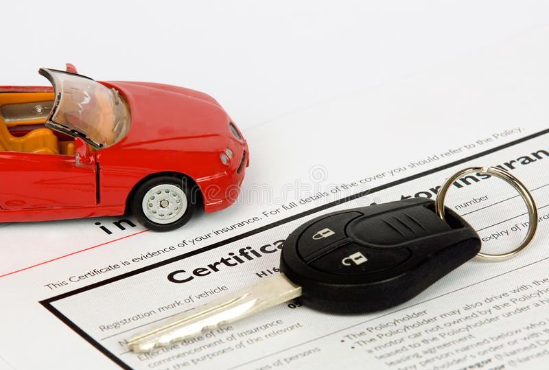 Car key on an insurance document. Image of a car key on an insurance document royalty free stock photo