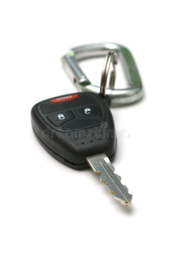 Car Key on Keychain. A car key with panic button, unlock and lock buttons, on a key chain with carabiner stock photo