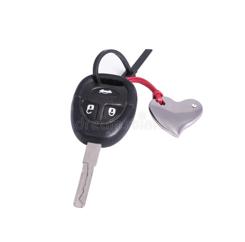 The car key in the keychain. In the shape of a heart on the white background royalty free stock image