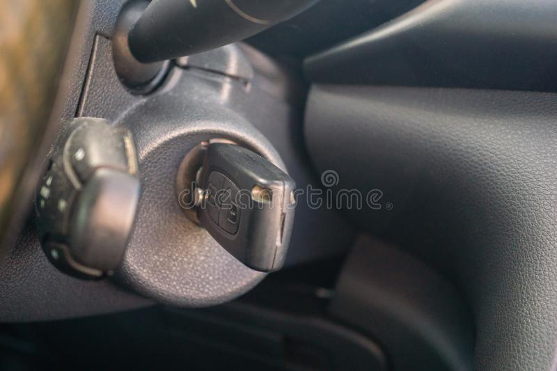 Car key in the keyhole, starting the car.  stock images