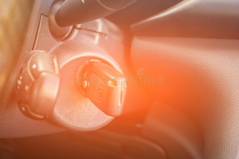 Car key in the keyhole, starting the car. Transport concept stock photography