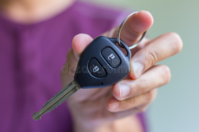 Car key in man hand. Man hand is holding a car key royalty free stock images
