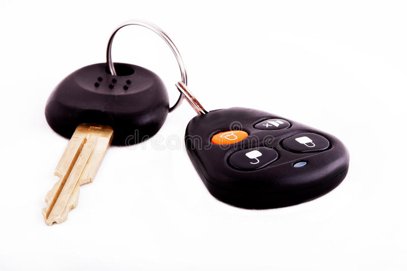 Car key and remote alarm. Control lock and alarm device isolated on a white background royalty free stock photos