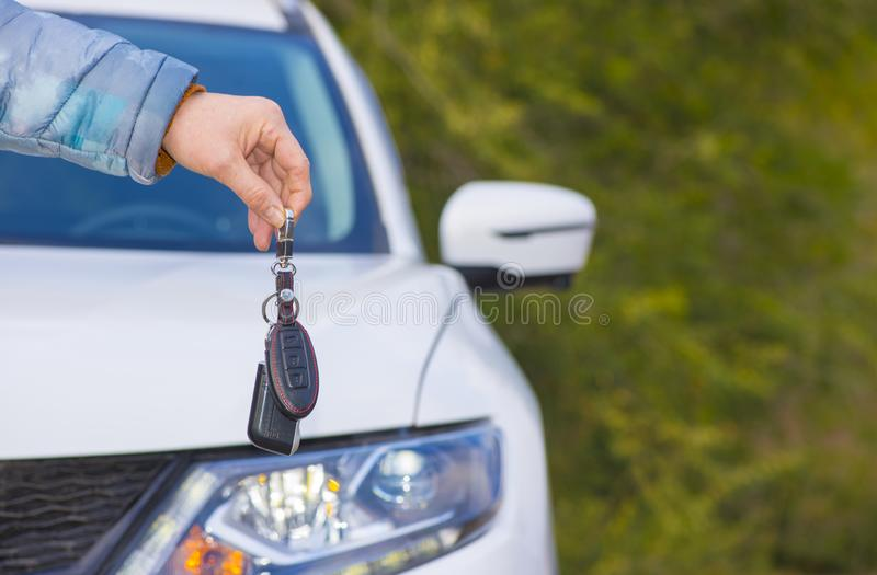 Car key ring. Keychain car keys on the background of the SUV royalty free stock photos