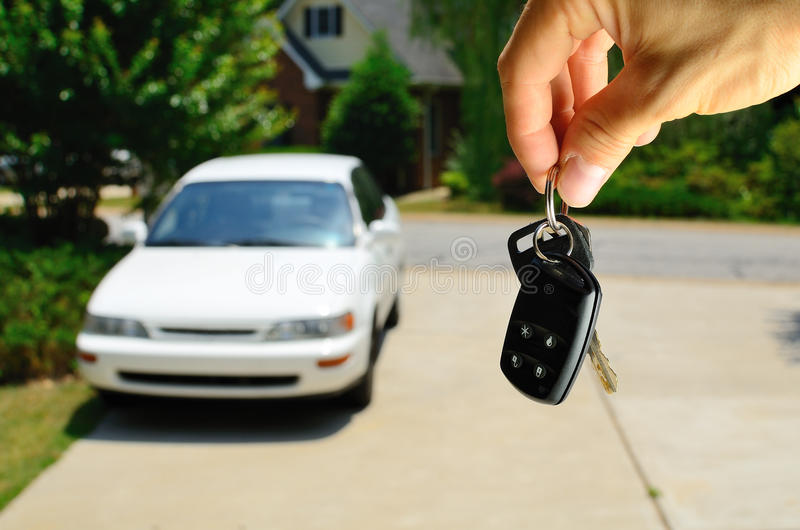 Car Keys. Handing over the keys to a used car stock image