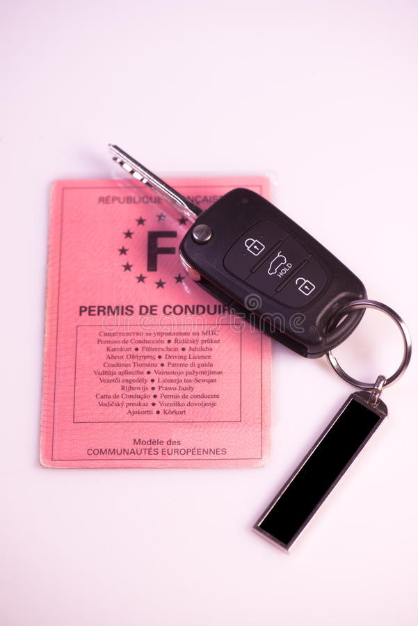 Car keys and drivers license on white background. France stock images