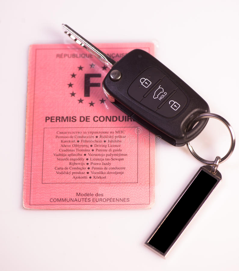 Car keys and drivers license on white background. France stock photos