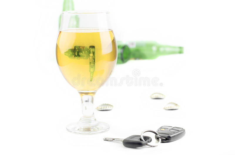 Car Keys And Glass Beer. With Empty Bottles On White Background stock photo