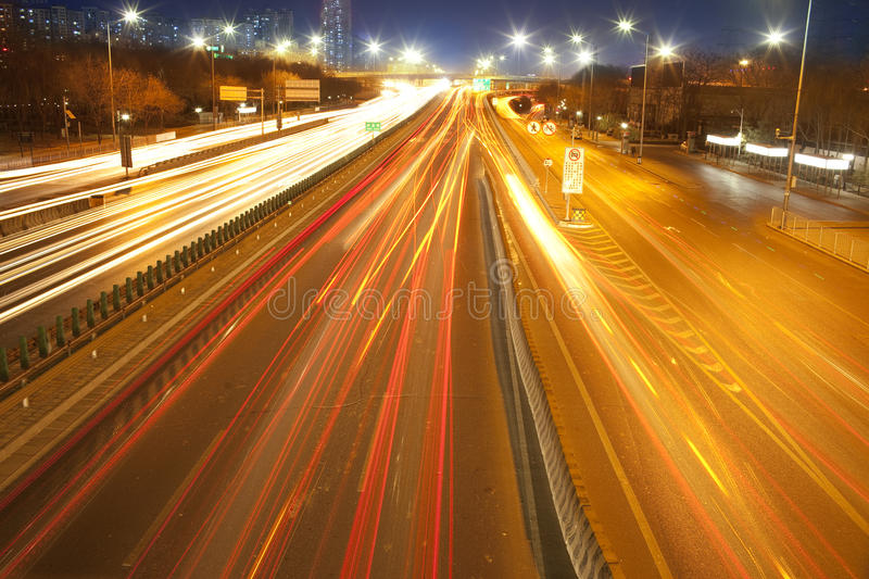 Car lamp track at night on the road stock photography