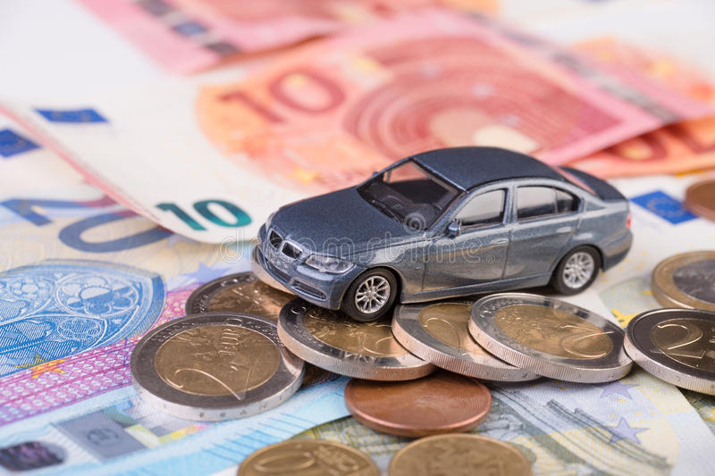 Car leasing transportation costs concept. Toy car on euro money, concept image for buying, renting, fuel or service and repair costs stock photography