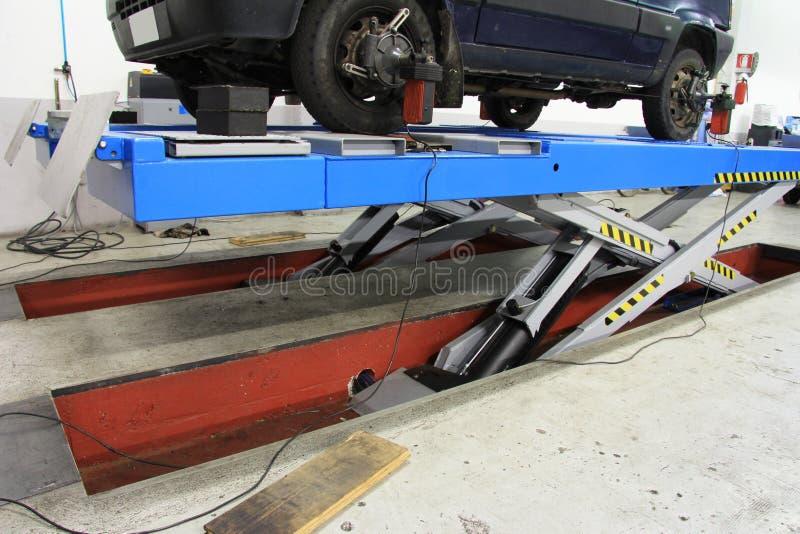 Car Lift At Garage Stock Photo