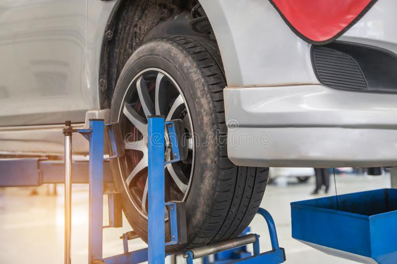 Car on lift to repair suspension to change motor oil and maintenance repair royalty free stock image