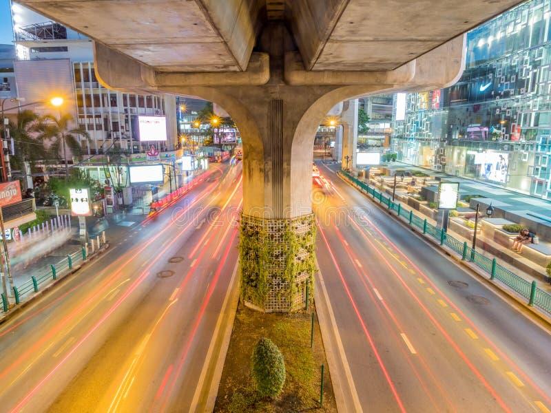 Car light movement in Bangkok. BANGKOK - AUGUST 8: Movement of car light on traffic road at Siam Square shopping center in Bangkok under twilight evening sky stock image