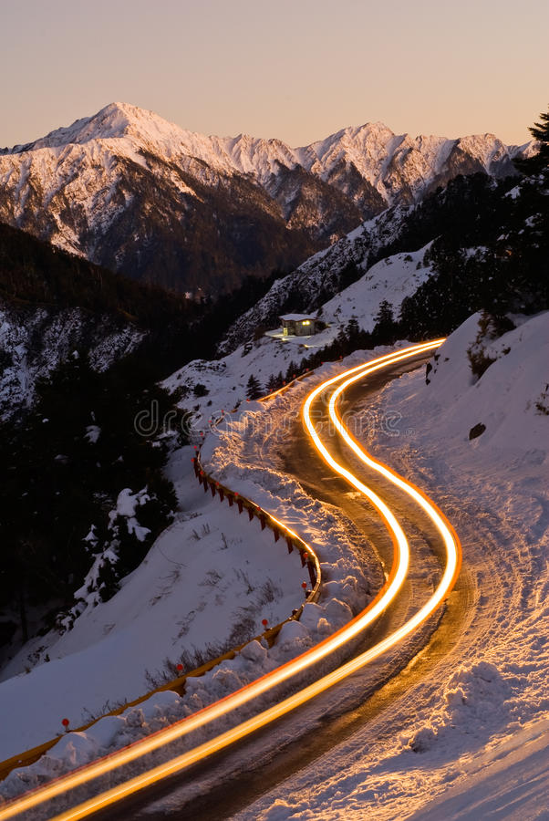 Car light in night on ice road. In snow winter mountain royalty free stock photos