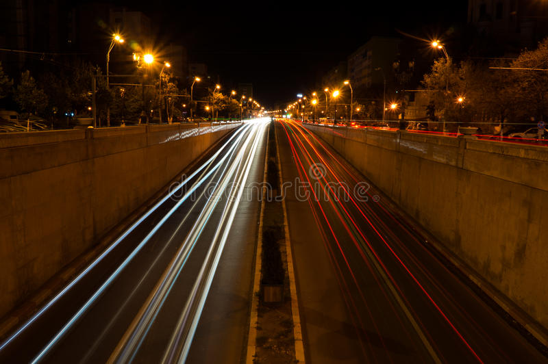 Car light trail at tunnel entrance stock photos