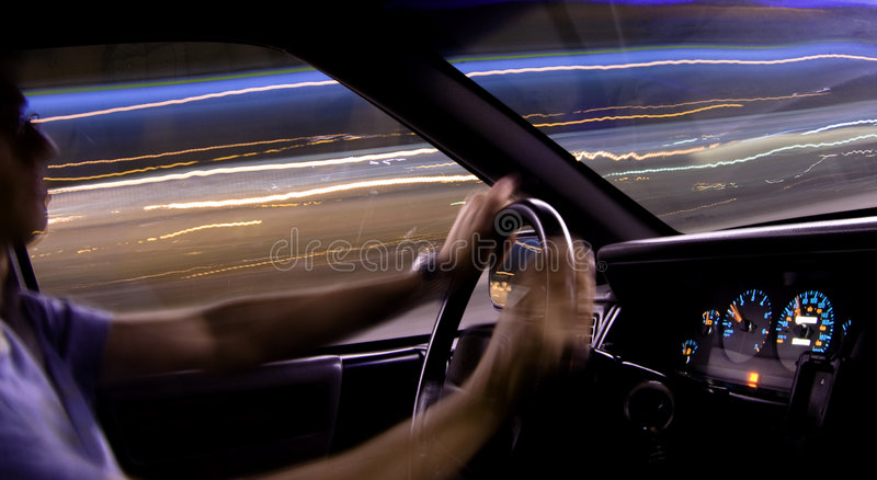 Car light trails - driver. Car light trails with driver. City in the night stock photo