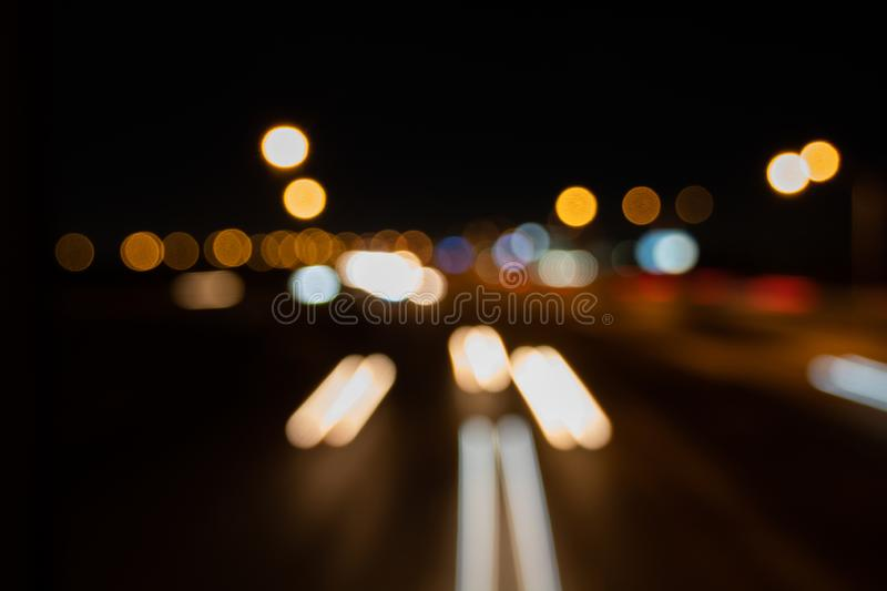 Car light trails on Interstate 75 at night time. Blurs and Bokeh Effect.  Art image. stock image