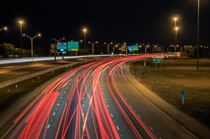 Car light trails on Interstate 75 at night time. Art image. Abstract lights in night time royalty free stock photo