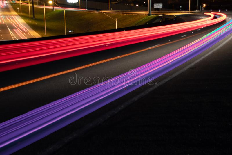 Car light trails on Interstate 75 at night time. Art image. Abstract lights in night time stock photography