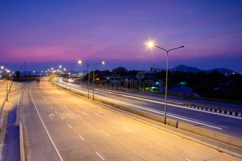 Car light trails on motorway with beautiful sky at twilight stock images