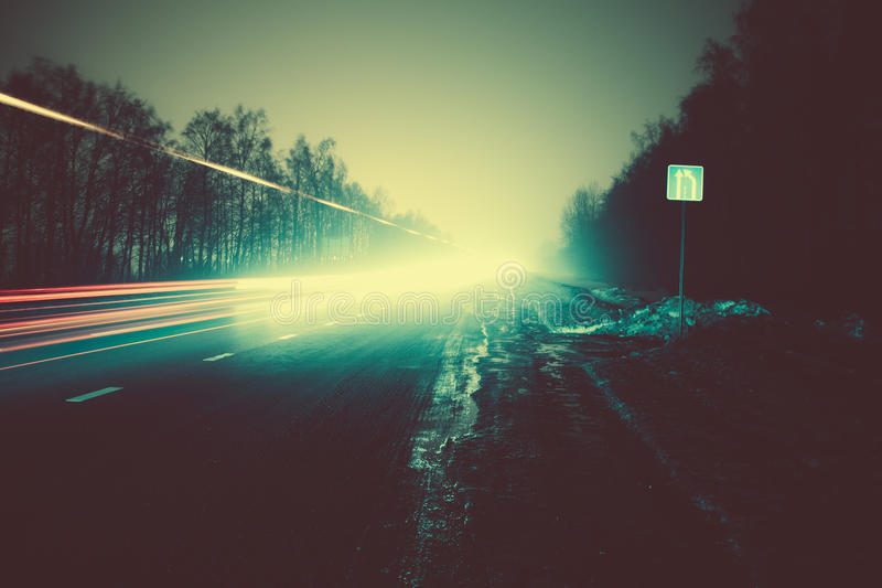 Car light trails in the road at night. Colorful car light trails in the road at night royalty free stock image