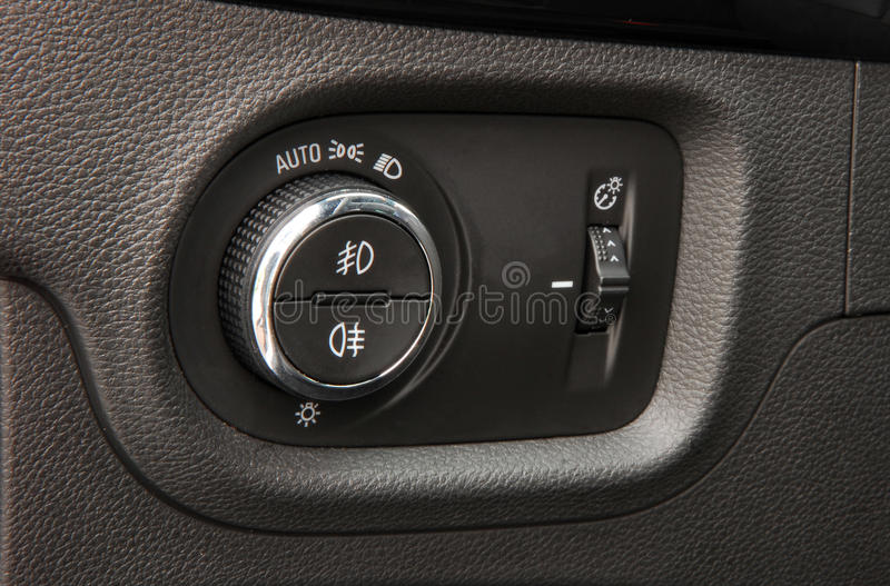 Car lighting switch. Closeup image of car lighting control switch stock photos