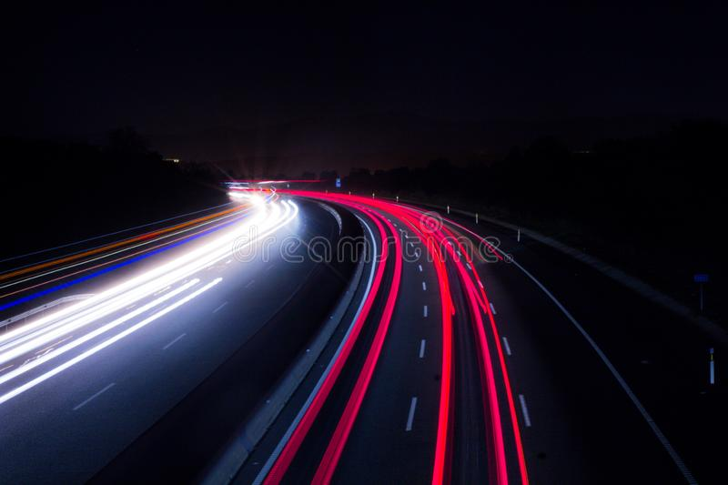 Car lights on highway with a dark night royalty free stock images