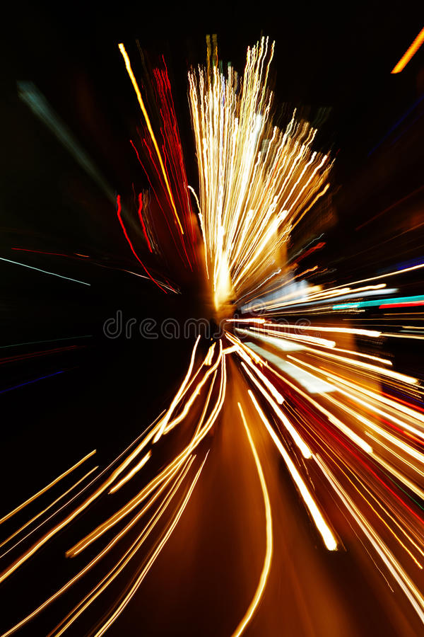 Car lights in motion blur with zoom effect. Night traffic in the city, car lights in motion blur with zoom effect royalty free stock photo