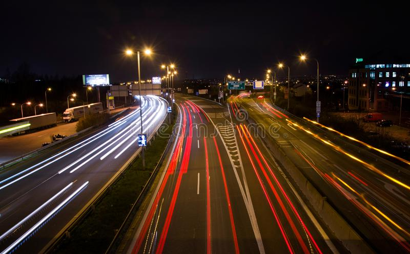 Car lights movement on the highway. Travel in the speed of light stock photo