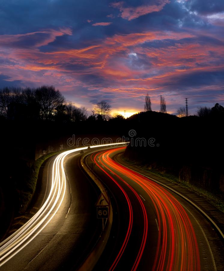 Car lights at night on the road stock image