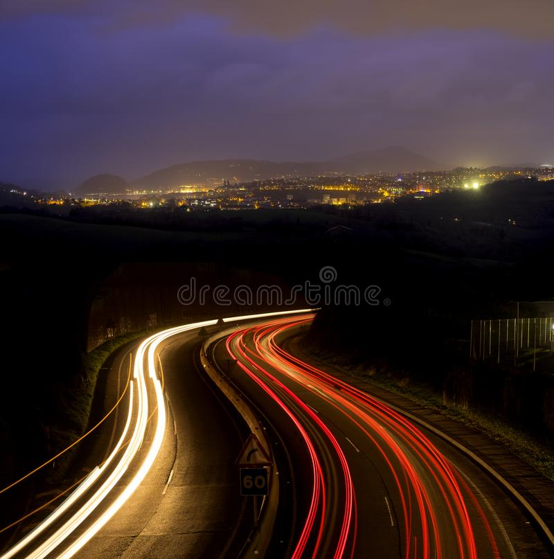 Car lights at night on the road royalty free stock photography